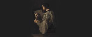 Filósofo sosteniendo un espejo